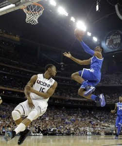 Kentucky's Terrence Jones shoots as Connecticut's Kemba Walker defends during the first half of a men's NCAA Final Four semifinal college basketball game Saturday, April 2, 2011, in Houston. (AP Photo/Eric Gay)