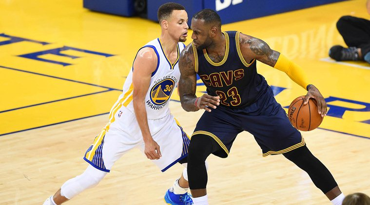 June 2, 2016; Oakland, CA, USA; Cleveland Cavaliers forward LeBron James (23) controls the ball against Golden State Warriors Stephen Curry (30) during the first half in game one of the NBA Finals at Oracle Arena. Mandatory Credit: Bob Donnan-USA TODAY Sports