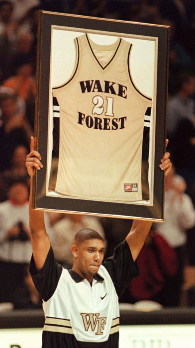 Tim holds his retired jersey at final Wake Forest game. Source: spiritscraps.com