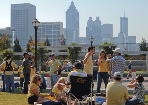 GT fans Tailgating with Atlanta skyline (Becky Stein/special) photo courtesy of abernathycochran.com